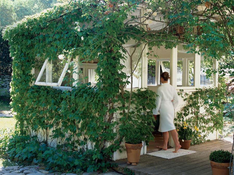 A backyard bathhouse and spa garden shed idea