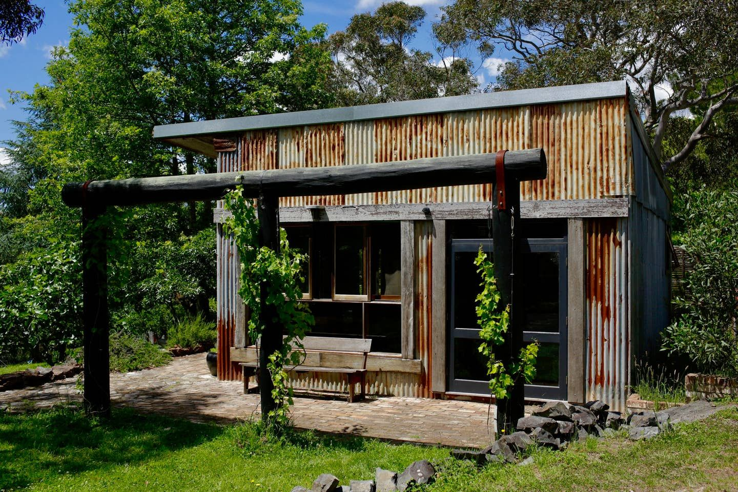 living in a shed made from recycled material
