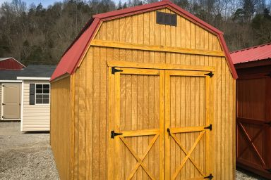 A portable building in Kentucky with wood siding and a metal roof