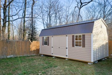 A portable building in Kentucky with vinyl siding and a metal roof