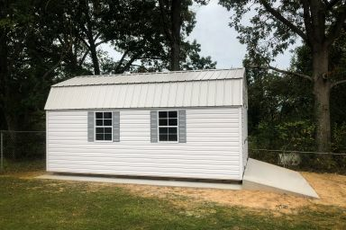 A lofted shed for sale in Kentucky with a concrete foundation