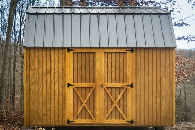 A lofted shed for sale in Kentucky with wood siding