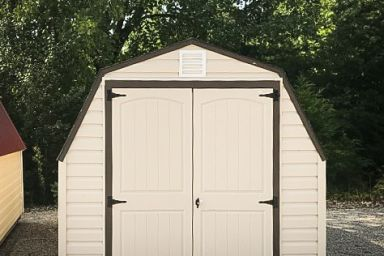 A portable building in Kentucky with vinyl siding and double doors