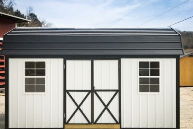 A portable building in Kentucky with metal siding and a black metal roof