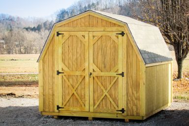 A portable building in Tennessee with wood siding