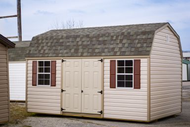 A shed in Kentucky with vinyl siding and a shingle roof