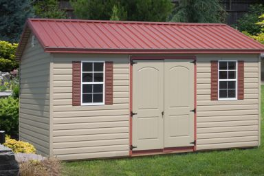 A shed in Kentucky with vinyl siding and a red metal roof