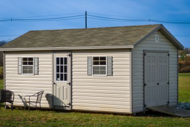 A shed in Kentucky with windows and double doors