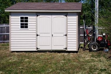 A vinyl shed being delivered in Kentucky with double doors and windows