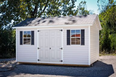 A white vinyl shed in Tennessee with double doors and a shingle roof
