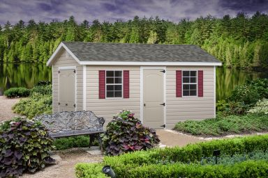 A vinyl shed in Tennessee with double doors and a shingle roof