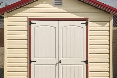 A shed in Tennessee with vinyl siding and double doors