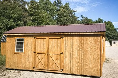 A shed in Tennessee with wooden siding, a window, and a metal roof