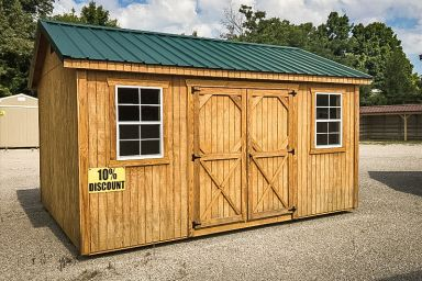 A discounted garden shed in Kentucky with wooden siding, double doors, and a green metal roof
