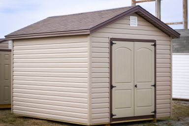 A storage shed in Kentucky with vinyl siding and double doors