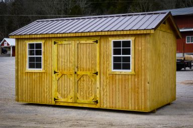 A storage shed in Kentucky with wooden siding, double doors, and a brown metal roof