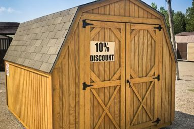 A discounted backyard shed in Kentucky with wooden siding, a shingle roof, and double doors