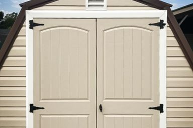 A backyard shed in Tennessee with vinyl siding, a metal roof, and double doors