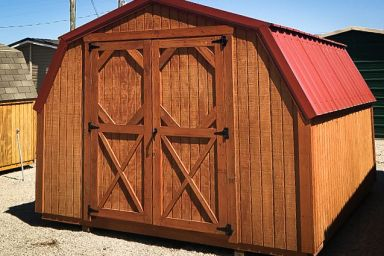 A backyard shed in Tennessee with wooden siding, a red metal roof, and double doors