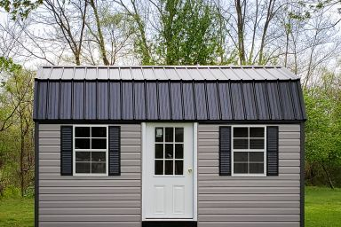 An outdoor shed in Kentucky with vinyl siding and a black metal roof