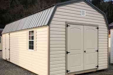 An outdoor shed in Kentucky with vinyl siding, a loft, and a metal roof