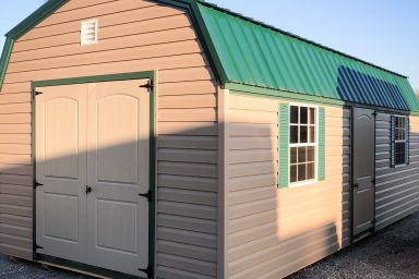 An outdoor shed in Kentucky with vinyl siding, two windows, and a green metal roof