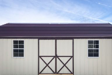 An outdoor shed in Kentucky with metal siding, two windows, and a metal roof