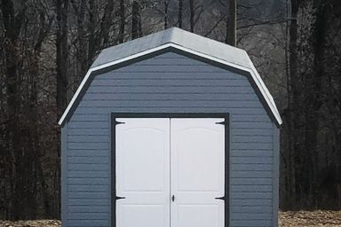 An outdoor shed in Kentucky with vinyl siding and double doors