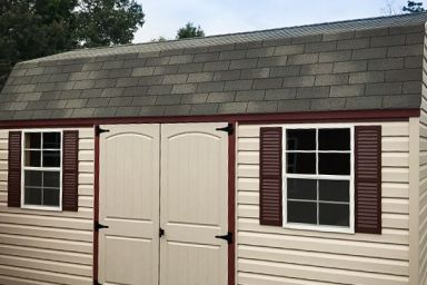 An outdoor shed in Tennessee with vinyl siding, double doors, and a shingle roof