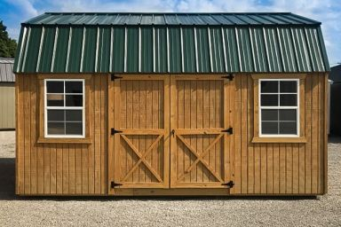 An outdoor shed in Tennessee with wood siding, double doors, and a green metal roof