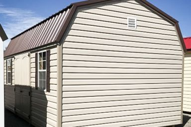 A lofted outdoor shed in Tennessee with vinyl siding