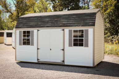 A prefab storage building in Kentucky with vinyl siding and double doors