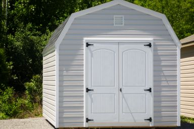 A storage building with a loft in Kentucky with vinyl siding and double doors
