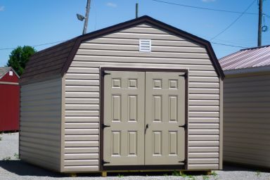 A storage building in Tennessee with vinyl siding and double doors