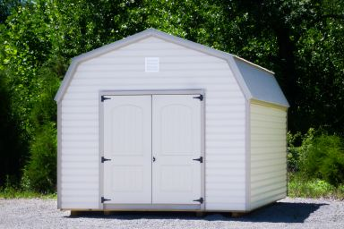 A prefab lofted storage building in Tennessee with vinyl siding and double doors