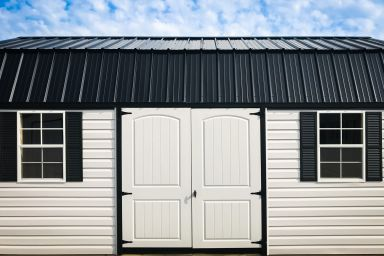 A storage building in Tennessee with a black metal roof