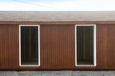A prefab wood cabin in Kentucky with a shingle roof