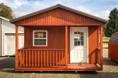 A prefab cabin in Kentucky with wooden siding and a front porch