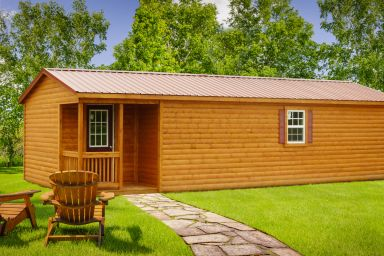 A prefab cabin in Tennessee with log siding and a metal