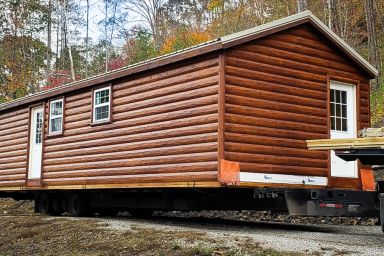 A portable cabin for sale in Kentucky with log siding
