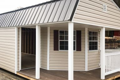 A tiny cabin for sale in Kentucky with vinyl siding and a front porch