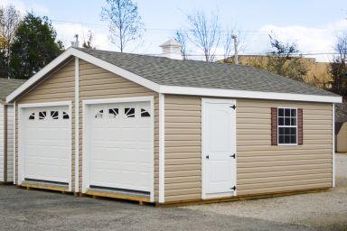 A multiple-car prebuilt garage in Kentucky with vinyl siding