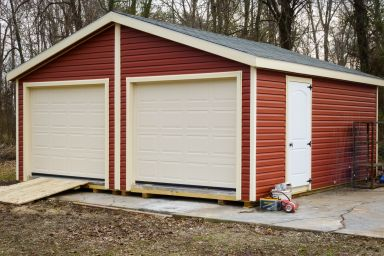 A doublewide prebuilt garage in Kentucky with red vinyl siding