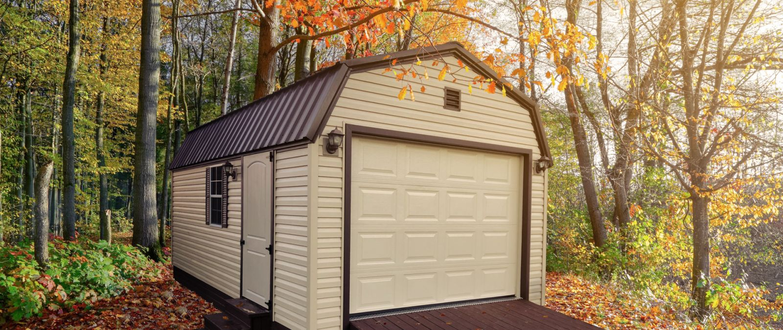 A custom prebuilt garage in Tennessee with brown vinyl siding and a loft