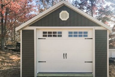 A prefab garage shed in Tennessee with custom vinyl siding