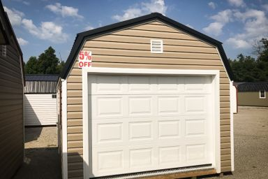 A discounted prefab garage in Kentucky with vinyl siding and a loft