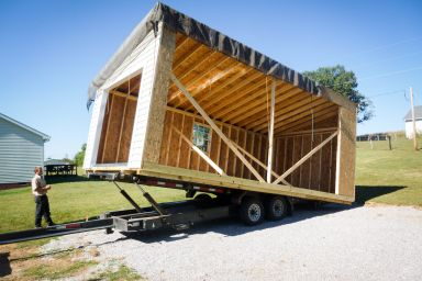 Half of a modular garage in Kentucky being delivered