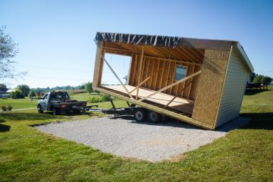 A modular garage in Kentucky being set on a gravel foundation
