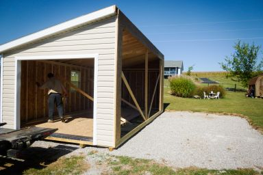 A modular garage with vinyl siding being delivered in Kentucky