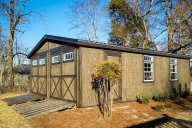 A double wide modular garage in Tennessee with wooden siding